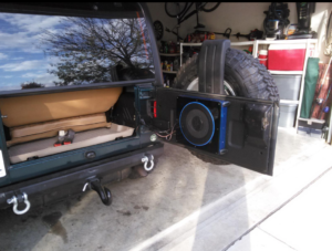 Some even fit the compact powered subwoofer on the trunk door.